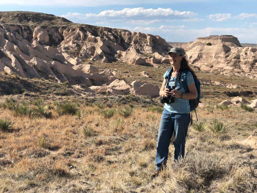 hiking in prairie near rock outcrops